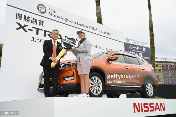 Fumika Kawagishi of Japan poses for a photograph after the final round of the Munsingwear Ladies Tokai Classic 2017 at the Shin Minami Aichi Country...