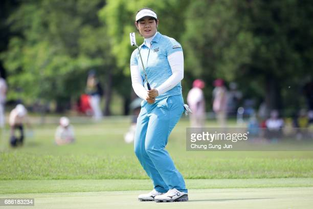 Fumika Kawagishi of Japan reacts after a putt on the 18th green during the final round of the Chukyo Television Bridgestone Ladies Open at the Chukyo...