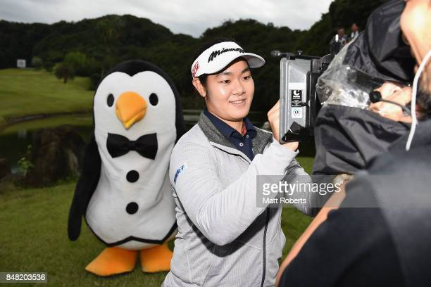 Fumika Kawagishi of Japan signs her autograph on a television camera during the final round of the Munsingwear Ladies Tokai Classic 2017 at the Shin...
