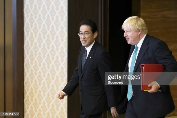 Fumio Kishida Japan's foreign minister left and Boris Johnson UK foreign secretary arrive for a meeting in Tokyo Japan on Friday July 21 2017...