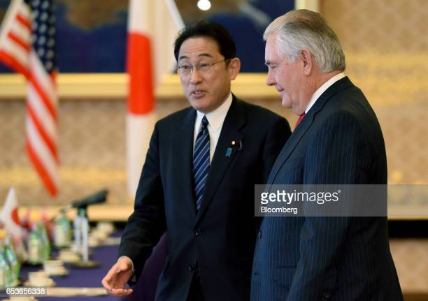 Fumio Kishida Japan's foreign minister left speaks with Rex Tillerson US Secretary of State ahead of a bilateral meeting in Tokyo Japan on Thursday...