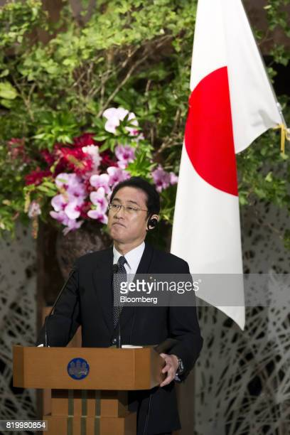 Fumio Kishida Japan's foreign minister listens as Boris Johnson UK foreign secretary not pictured delivers a joint statement after their meeting in...