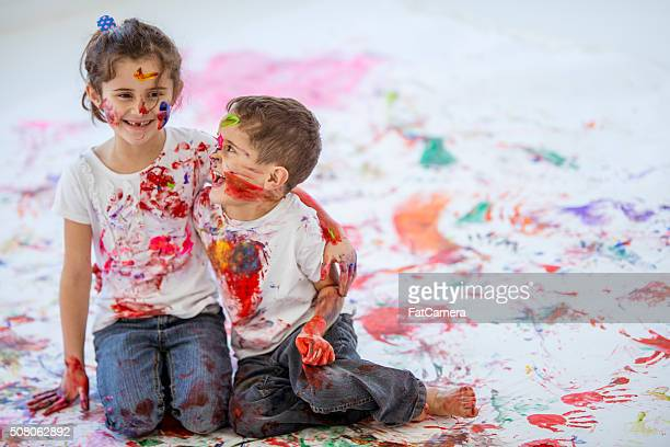 Fun Childhood Finger Painting Brother and Sister