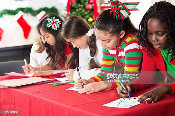 Fun friends create Christmas cards