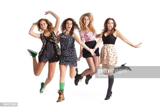 Fun Loving Jumping Young Teen Girls on White Background