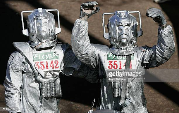 Fun runners dressed as Cybermen celebrate after crossing the finish line during the 2005 Flora London Marathon on April 17 2005 in London