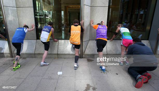 Fun Runners queue up to receive treatment on their legs as they exit Canary Wharf during the Virgin Money London Marathon 2014 on April 13 2014 in...