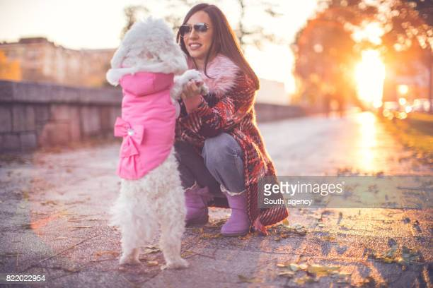 Fun with her white dog