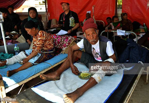 Funchu Tamang eats on a bed in a hospital in Nuwakot district on May 4 2015 around 80 kilometres northwest of Kathmandu Police had initially said...