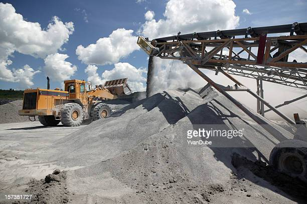 Functioning industrial quarry with trucks at work