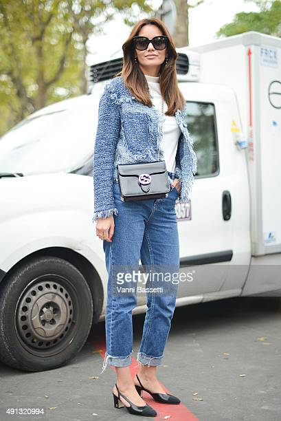 Funda Christophersen poses wearing a M Missoni jacket Gucci bag Topshop pants and Chanel shoes before the John Galliano show at the Palais de Tokyo...