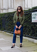 Funda Christophersen wearing an olive bomber from Topsop Loewe bag Proenza Shouler shoes and a blue denim jeans seen outside Topshop during London...