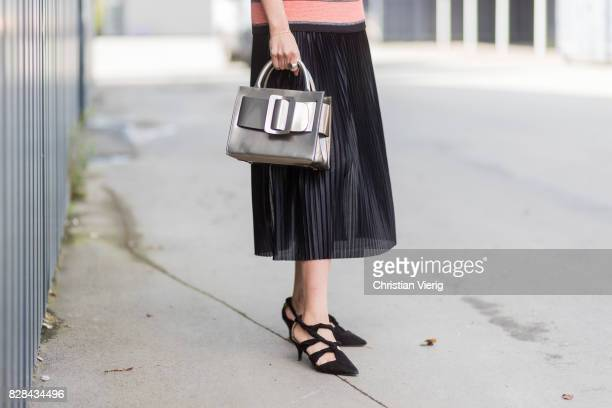 Funda Christophersen wearing knit silver bag and black skirt outside By Malene Birger on August 09 2017 in Copenhagen Denmark