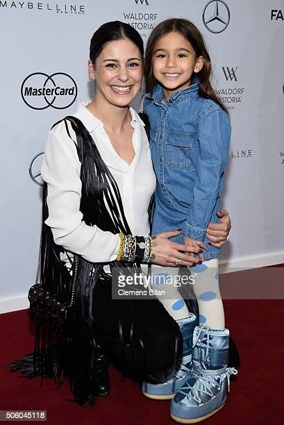 Funda Vanroy and her daughter Emilia attend the Dimitri show during the MercedesBenz Fashion Week Berlin Autumn/Winter 2016 at Brandenburg Gate on...