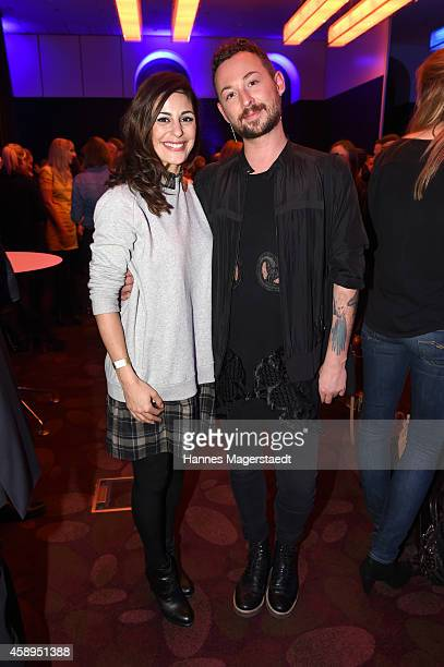 Funda Vanroy and Marcel Ostertag attend the Marcel Ostertag Charity Fashion Show at Sofitel Munich Bayerpost on November 13 2014 in Munich Germany