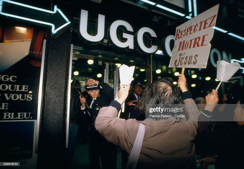 Fundamentalist Christians, holding signs reading 'Respect Our Jesus,' protest the release of director Martin Scorsese's 1988 film 'The Last Temptation of Christ' outside Paris movie theaters. The scandalous film, based on the novel by Nikos Kazantzakis, starred Willem Dafoe and Harvey Keitel.