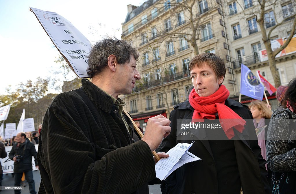 Funder of 'Osez le Feminisme' (Dare Feminism) movement, working in the cabinet of French Minister for Women's Rights, Caroline de Haas (R) takes part in a demonstration called by the Women rights national collective, on November 25, 2012 in Paris, as part of the International Day for the Elimination of Violence Against Women. Since 1999, the United Nations each year invites governments, international organizations and NGOs to organize activities designed to encourage the public to fight such violence.