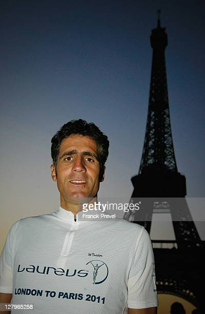 Fundraiser Miguel Indurain poses by the Eiffel Tower during the Laureus Bike Ride London to Paris on October 01 2011 in Paris France