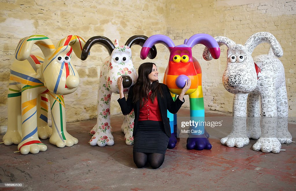 Fundraising manager Lauren Vincent poses with four Gromit sculptures, out of around 70 which have been painted by celebrity artists, (L-R) Sir Paul Smith, Cath Kidston, Richard Williams and Simon Tofield, before they are placed around the city for public view as part of charity initiative arts trail, on April 19, 2013 in Bristol, England. After being displayed to the public from July 1, the sculptures will be eventually auctioned off to raise funds for the Bristol Children's Hospital charity, Wallace & Gromit's Grand Appeal.