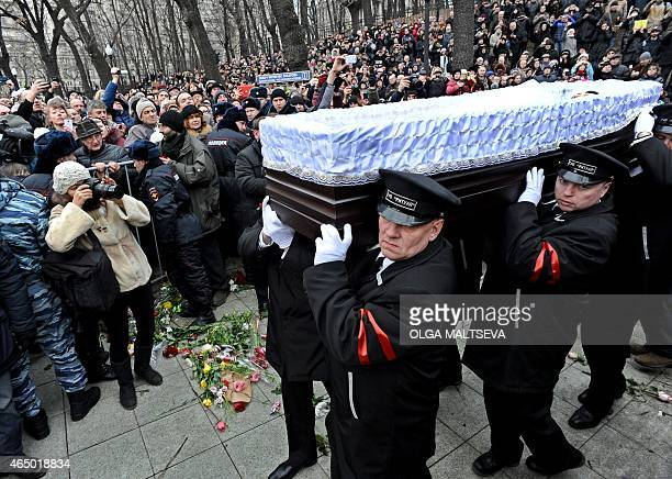 Funeral assistants carry the coffin of Russian opposition leader Boris Nemtsov after a memorial service at the Andrei Sakharov rights centre in...