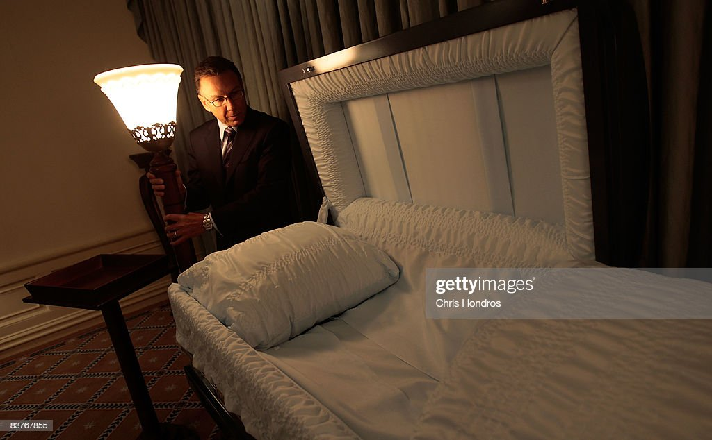 Funeral director Peter DeLuca, owner of Greenwich Village Funeral Home looks over a casket in his funeral parlor on November 20, 2008 in New York City. Despite the currently languishing economy, the funeral home world is readying for an upswing nationally, as the recession-resistant business prepares for an expected rise in death rates as baby boomers start to reach old age in the coming decade.