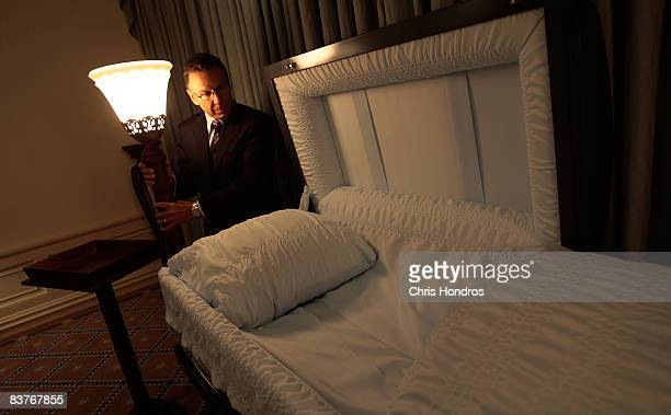 Funeral director Peter DeLuca owner of Greenwich Village Funeral Home looks over a casket in his funeral parlor on November 20 2008 in New York City...