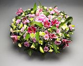 Funeral flower arrangement. Studio shot.