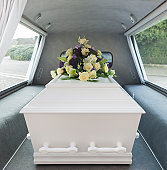 A casket in the back of an open hearse