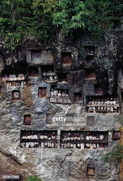 Funeral niches with Tau Tau mortuary figures Lemo village Tana Toraja Sulawesi island Indonesia