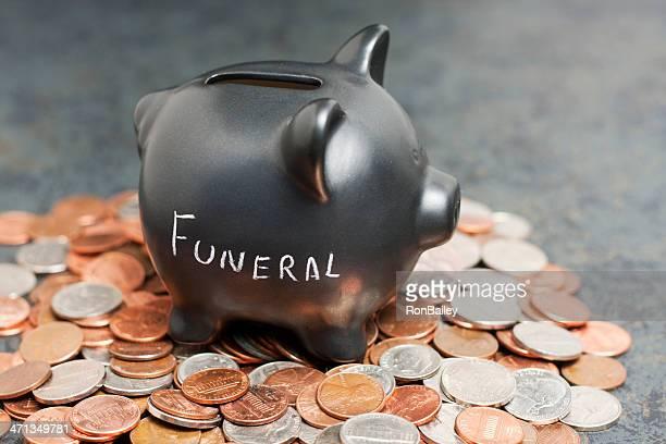 """""""Begräbnis"""" Sparschwein auf Münzen"""