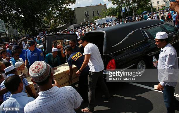 Funeral prayers are given over the caskets containing the bodies of Imam Maulama Akonjee and friend Thara Uddin August 15 2016 in New York New York...