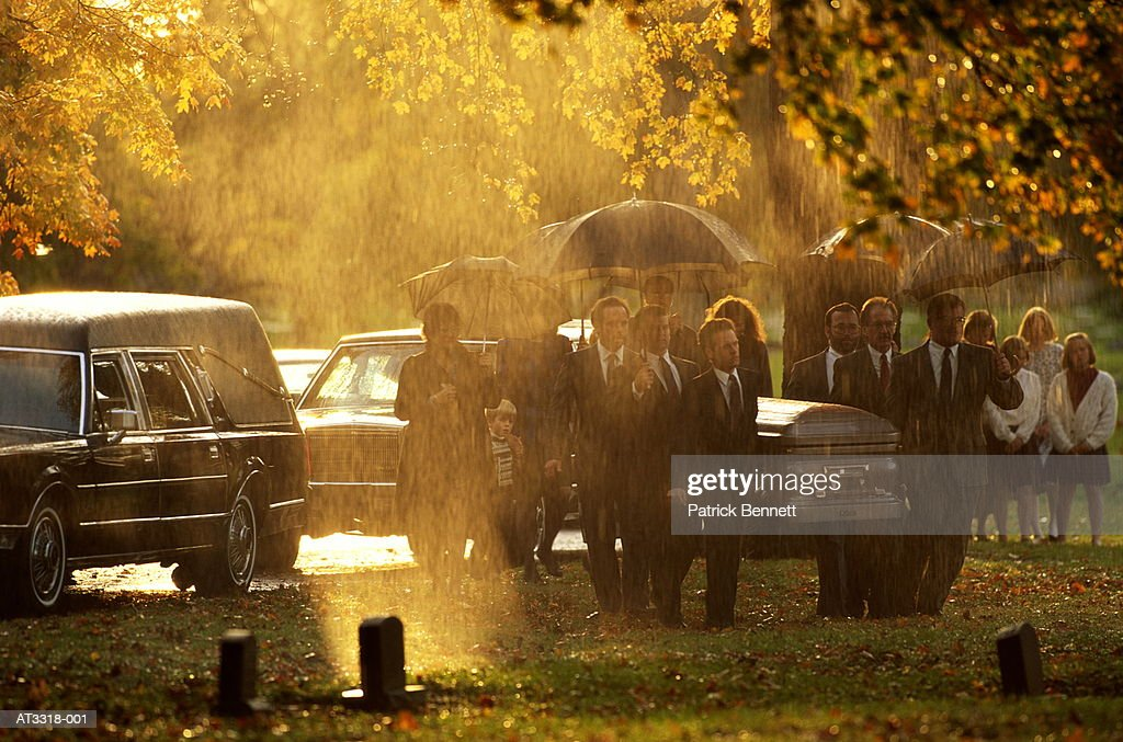 Funeral procession in cemetery during rainstorm, Indiana, USA : Stock Photo