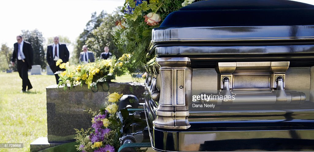 Funeral procession in cemetery. : Stock Photo