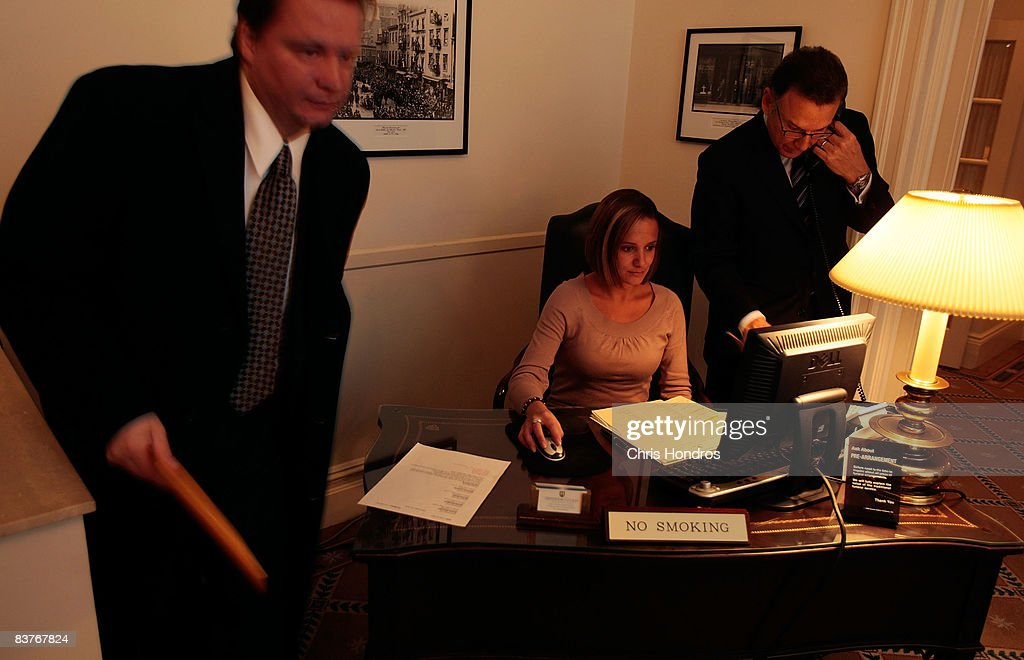 Funeral resident in training Jennifer Greenberg (C) operates a computer while attendant Adam Romanowski (L) and owner Peter DeLuca (R) work at the Greenwich Village Funeral Home on November 20, 2008 in New York City. The funeral home is one of New York's most historic, and is the oldest in a building designed from the ground up as a funeral parlor. Despite the currently languishing economy, the funeral home world is readying for an upswing nationally, as the recession-resistant business prepares for an expected rise in death rates as baby boomers start to reach old age in the coming decade.