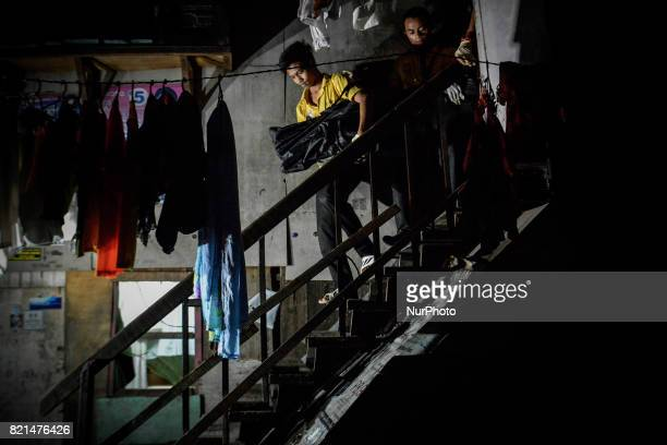Funeral workers carry the body of a man who was killed by police in what they say was a drug buybust operation in Manila Philippines July 13 2017 The...