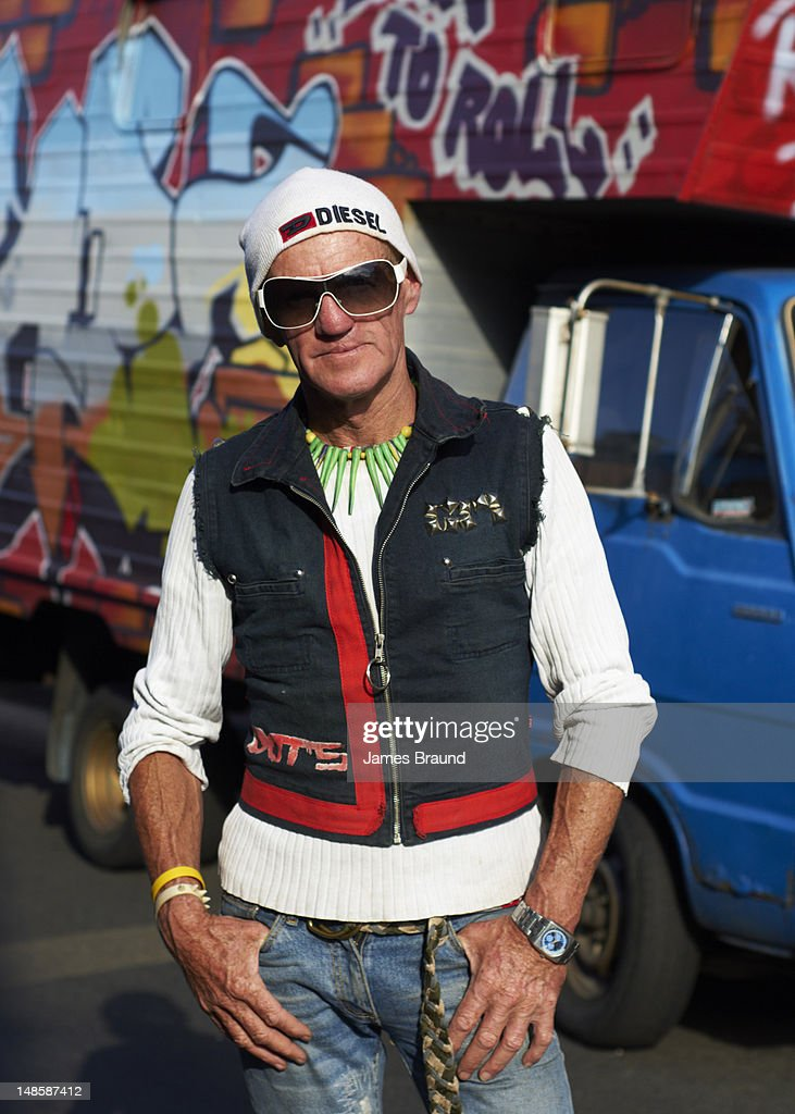 Funkily dressed senior man in Chapel Street, Prahran. : Stock Photo
