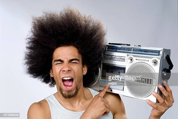 funky man singing to music on portable radio