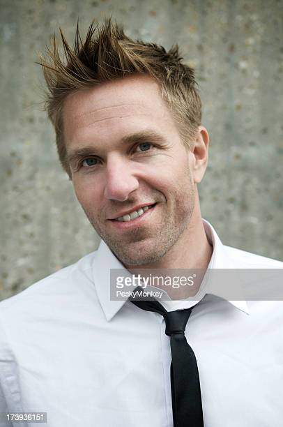 Spiky hair stock photos and pictures getty images funky spiky hair guy portrait urmus Image collections
