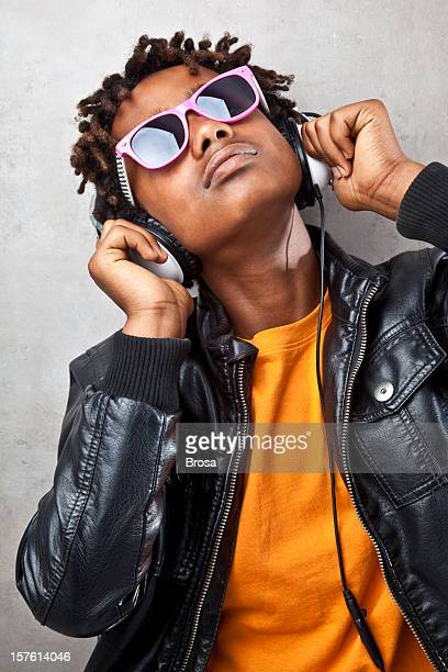 Funky teenager listening to headphones