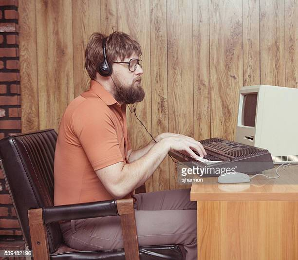 Funny 1980s man playing synthesizer DAW