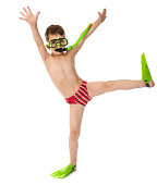 Funny boy in diving mask and flippers, isolated on white