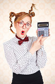 Portrait of surprised funny businesswoman with glasses holding calculator over orange retro backgroundYOU ARE WELCOME TO VISIT SOME OF MY MANAGED LIGHTBOXES