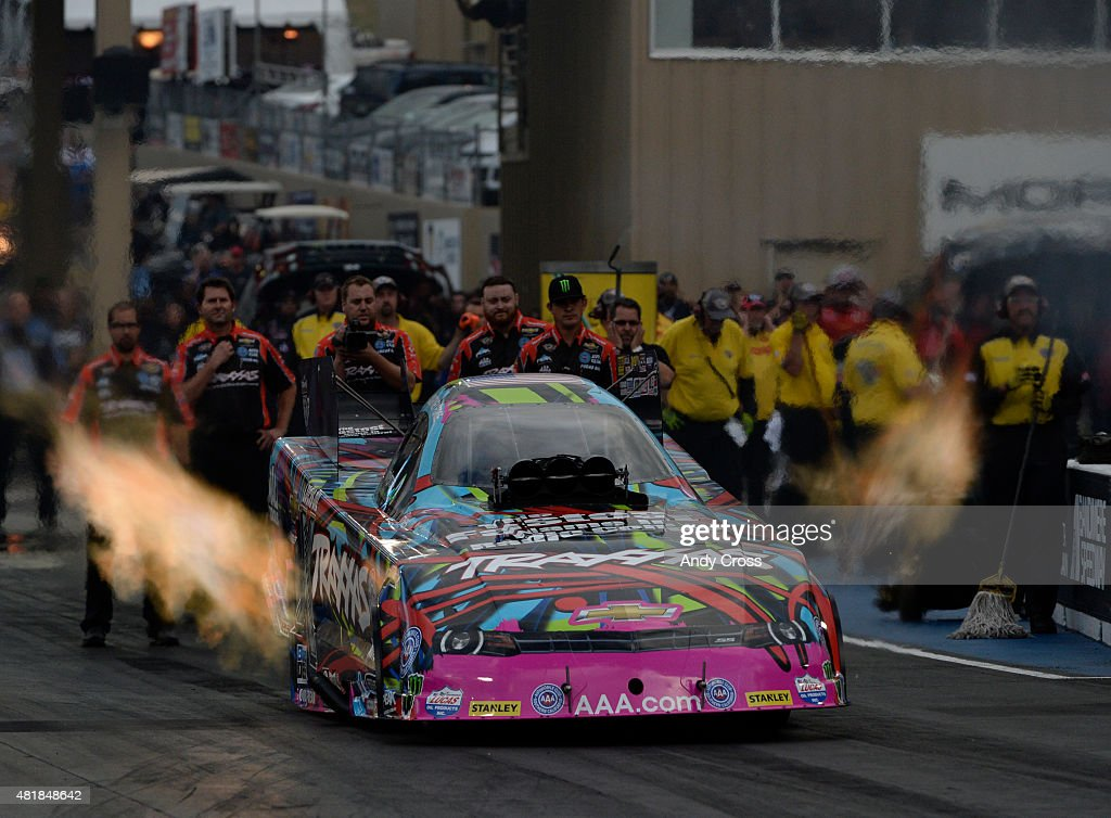 Funny Car <a gi-track='captionPersonalityLinkClicked' href=/galleries/search?phrase=Courtney+Force&family=editorial&specificpeople=8957288 ng-click='$event.stopPropagation()'>Courtney Force</a> takes off the start line during her first qualifying run of the 2015 Mopar Parts Mile High Nationals at Bandimere Speedway July 24, 2015.