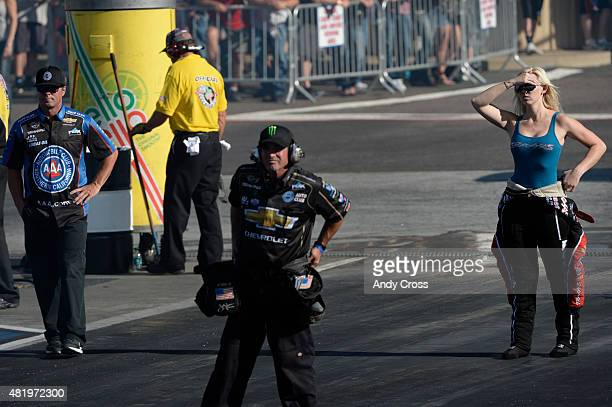 Funny Car driver Courtney Force watches her father legendary NHRA Funny Car driver John Force race on the second day of qualifying for the Mopar...