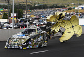 NHRA Funny Car driver John Force deploys his chutes after a record run during the Mopar MileHigh Nationals at Bandimere Speedway July 23 2016