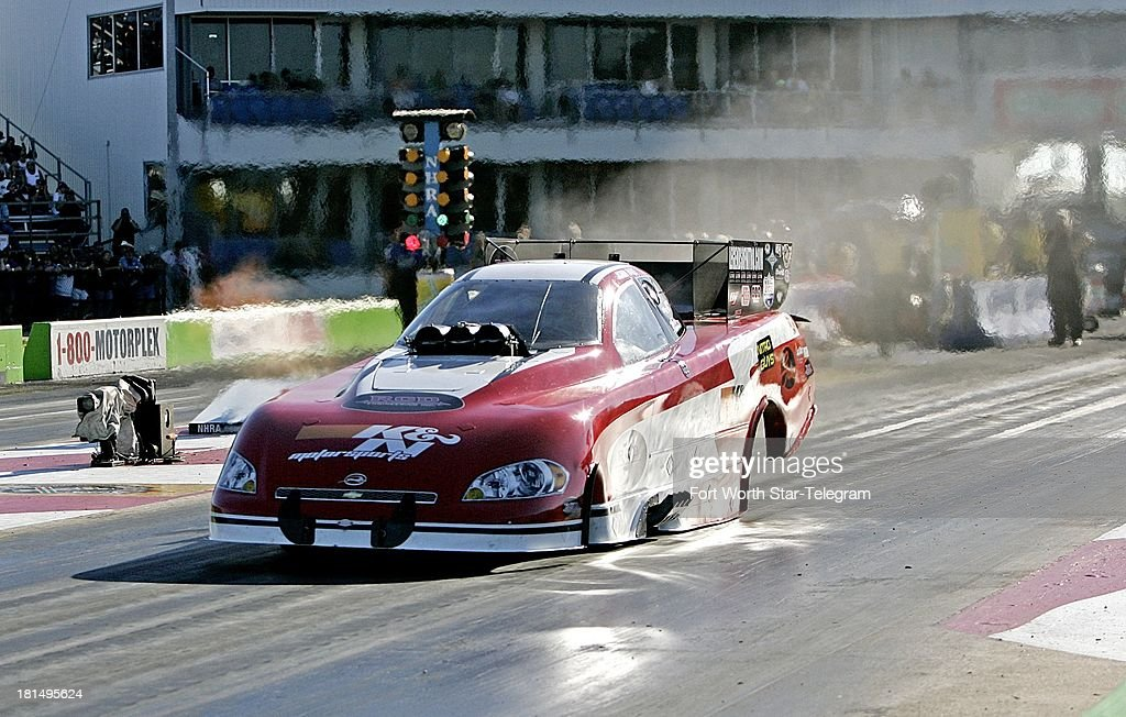 Funny Car driver John Hale drags his body at the start of the race during the Texas Fall Nationals at Texas Motorplex in Ennis, Texas, on Saturday, September 21, 2013.
