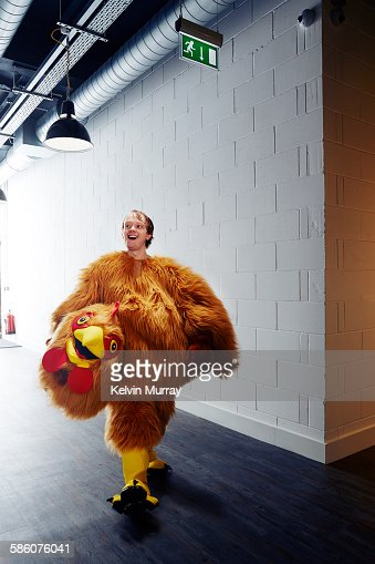 Funny chicken costume mascot smiling after event
