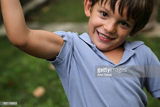 Funny child showing his bicep musculature