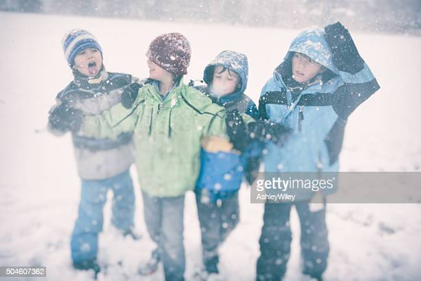 Funny children playing in the snow