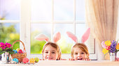 Two Sisters In Domestic Life Playing With Bunny Costume